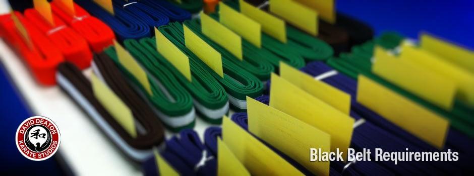 folded karate belts on table